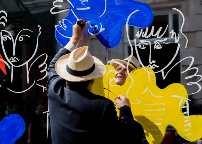 "Jeff Moore ""FREE FOR EDITORIAL USE"" Celebrated artist and designer Jean-Charles de Castelbajac covers Covent Garden with colourful clouds to launch Covent Garden ""After Hours"" a new series of late night shopping events throughout July. For more information please contact jade.beaty@edelman.com"