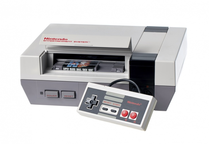 Taipei, Taiwan - July 4, 2012: This is a studio shot of a Nintendo Entertainment System and controller made by Nintendo Co. isolated on a white background.