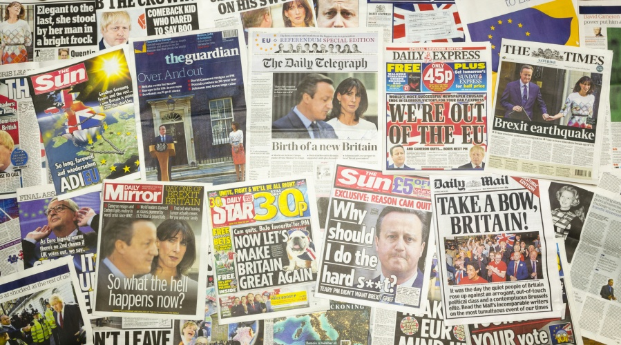 London, England - June 25, 2016: British newspaper front pages reporting Prime Minister David Cameron resigning after the EU Referendum.