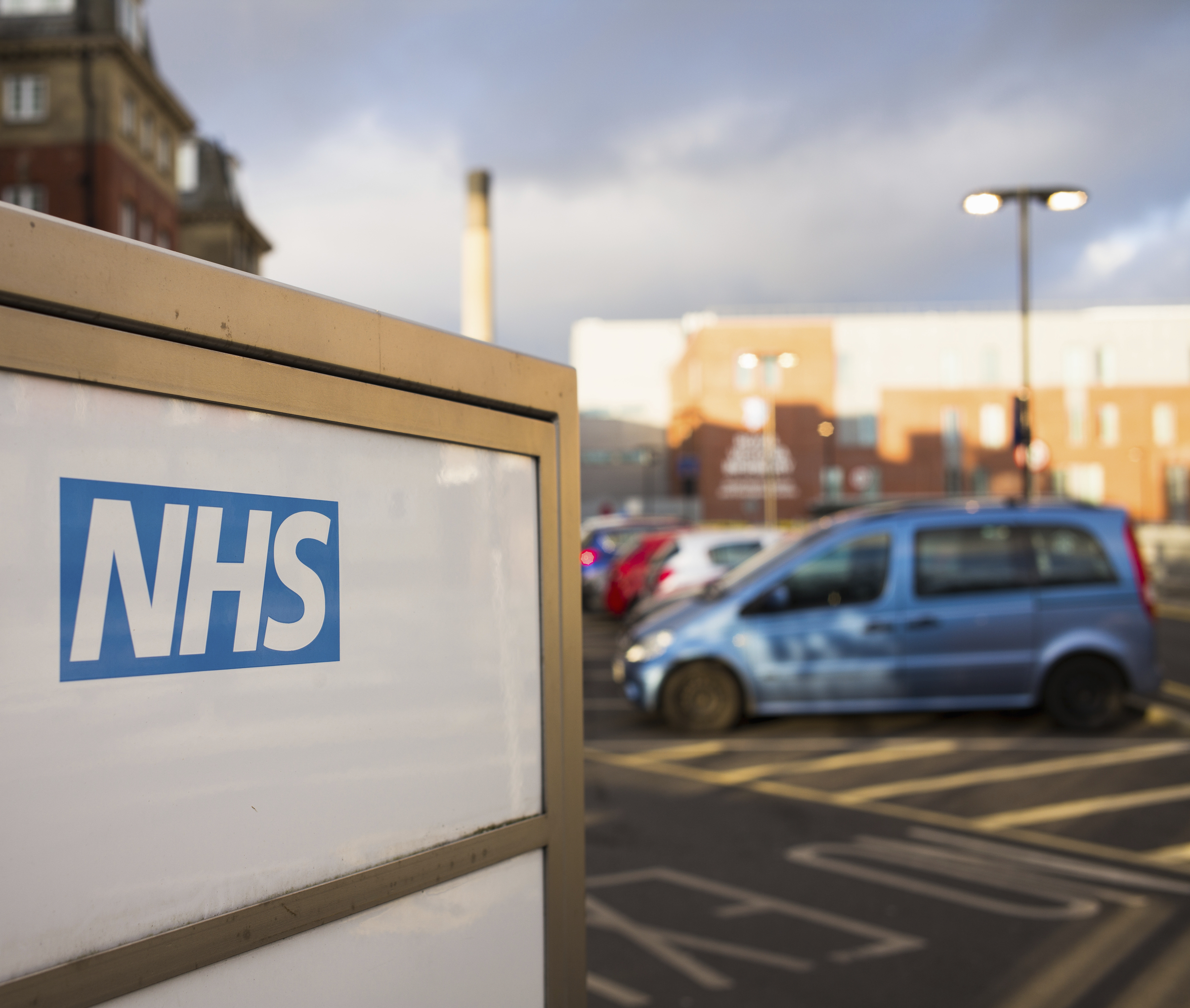 Newcastle, UK - February 10, 2016: The NHS (National Health Service) logo on an entrance sign for the Royal Victoria Infirmary, a teaching hospital which includes an accident and emergency department.