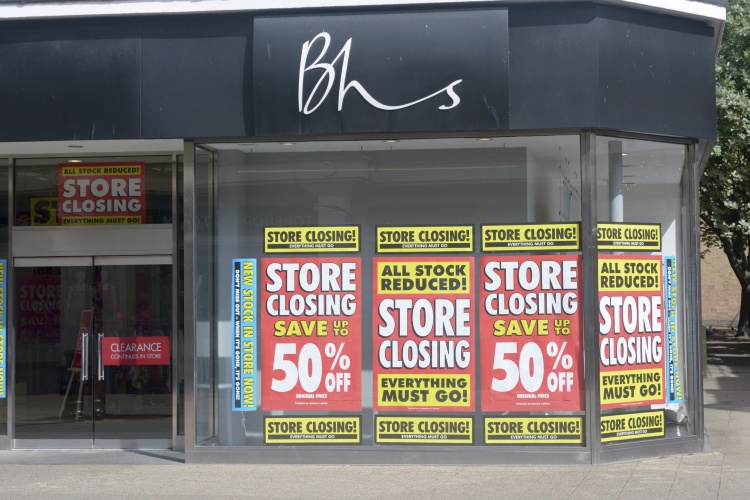 Bedford, England - June 28, 2016: Store Closing signs in British Home Stores (BHS) window in British Town Centre