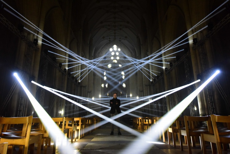 jason-bruge-stands-in-the-nave-of-york-minster-featuring-light-masonry-by-jason-bruges-studio-part-of-illuminating-york-2016-c-anthony-chappel-ross