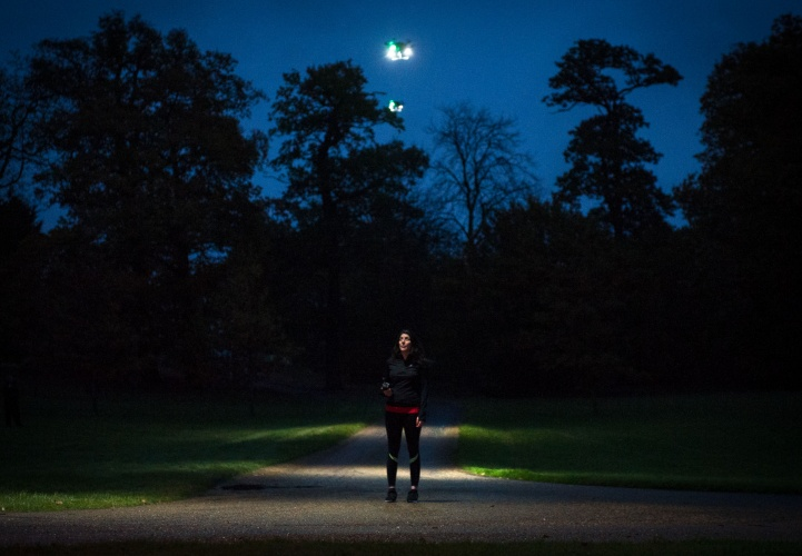 EMBARGOED TO 0001 WEDNESDAY NOVEMBER 16 EDITORIAL USE ONLY Jogger Francestca Monticelli during the launch of ÔFleetlightsÕ Ð a prototype range of smart drones fitted with high-powered lights, which have been designed by Direct Line and can be ordered by phone to improve road and pedestrian safety at night, at Borehamwood, Hertfordshire.  PRESS ASSOCIATION Photo. Issue date: Wednesday November 16, 2016. The insurance provider has partnered with the drone technology specialists behind Mission Planner to create the prototype Fleetlights mobile phone app, which makes it simple to control the service and track your journey using your GPS location. The software is the first time the ÔLight my WayÕ functionality - which tracks and maintains a fixed distance ahead of a subject, rather than behind - has been used.  Photo credit should read: John Nguyen/PA Wire