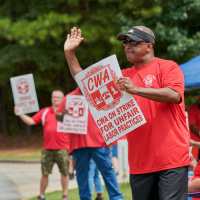 CWA members at a previous demonstartion protesting AT&T.
