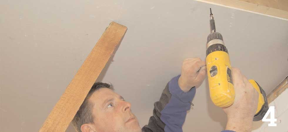 Use 38mm plasterboard screws to fix the board to the joists and noggings
