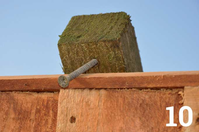 A screw through the top of the batten forms a neat hook that stops the panel from moving