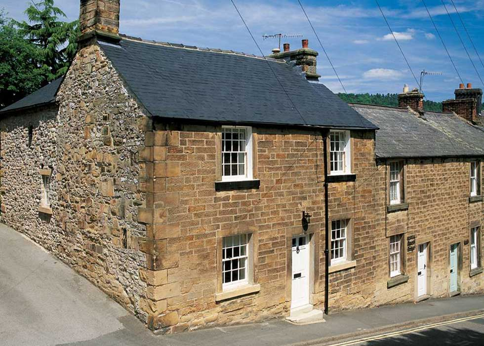 The Party Wall Act had to be considered when renovating this Grade II Listed cottage at the end of a row of terraced houses