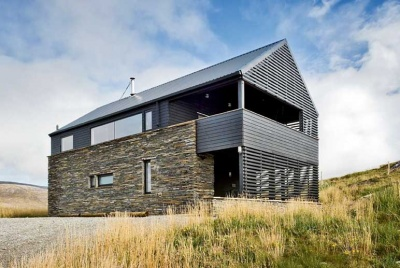 A timber clad beach house in the Hebrides