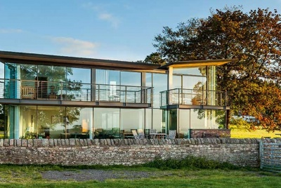 This award-winning  organic-style home uses stone and glass to masterly effect