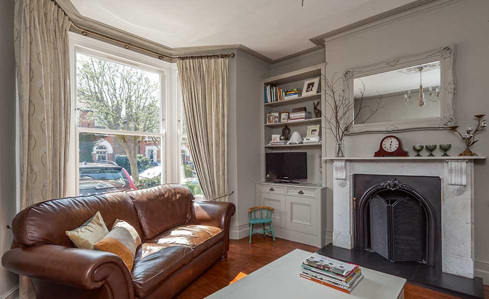 grey living room in an east London home where the couple did most of the renovating themselves