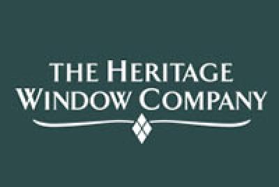 the heritage company logo green
