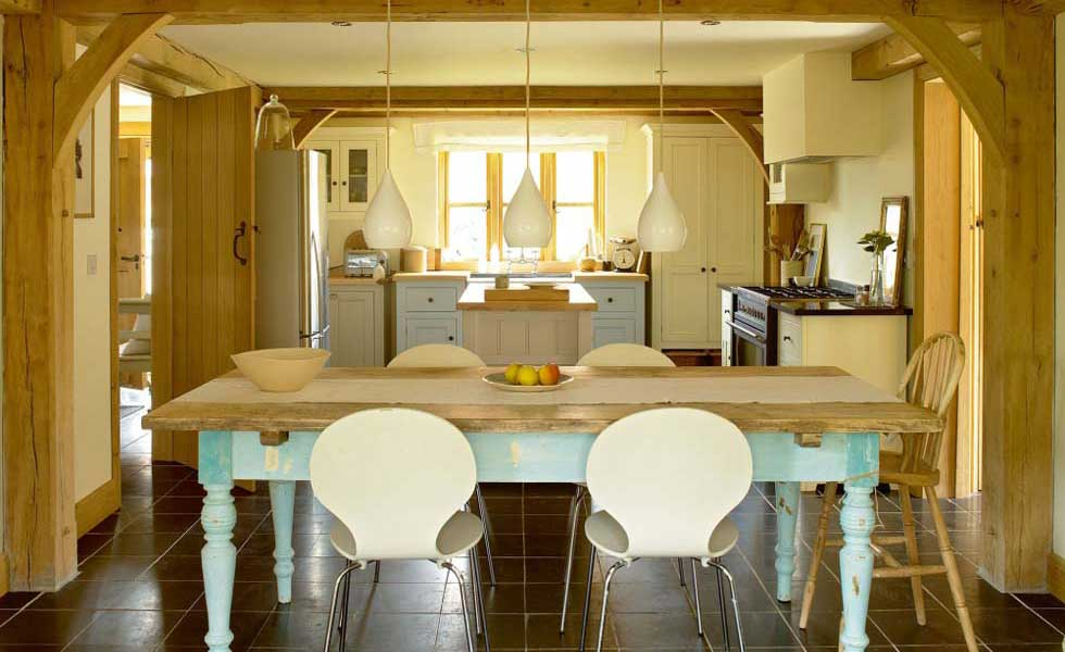 traditional kitchen with farmhouse kitchen table and pendant lights
