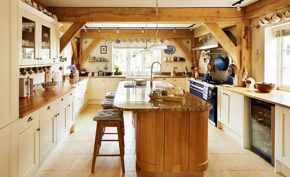 oak frame kitchen with hanging mugs and wooden island