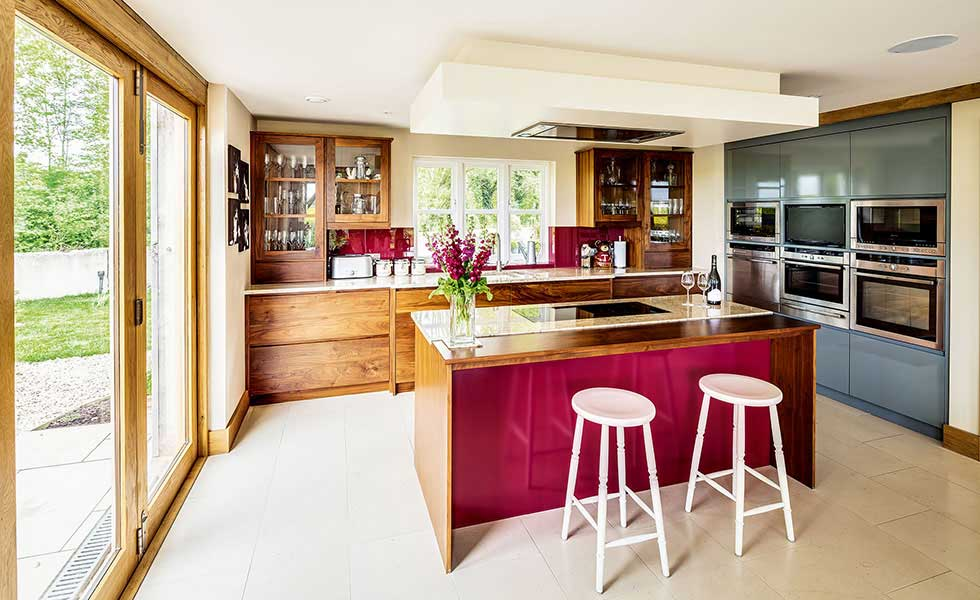 kitchen with red splash back and wooden cupboards