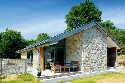 granite clad self build with timber cladding
