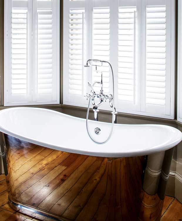 A copper freestanding bathtub