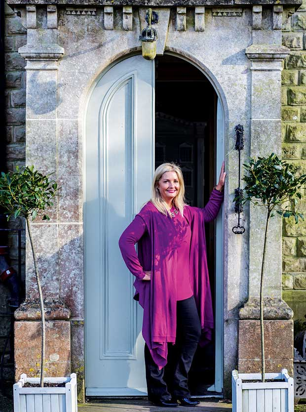 Homeowner Julia Dempster stands in front of the entrance to her Victorian country house
