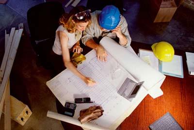 Building Regulations - Looking over blueprints