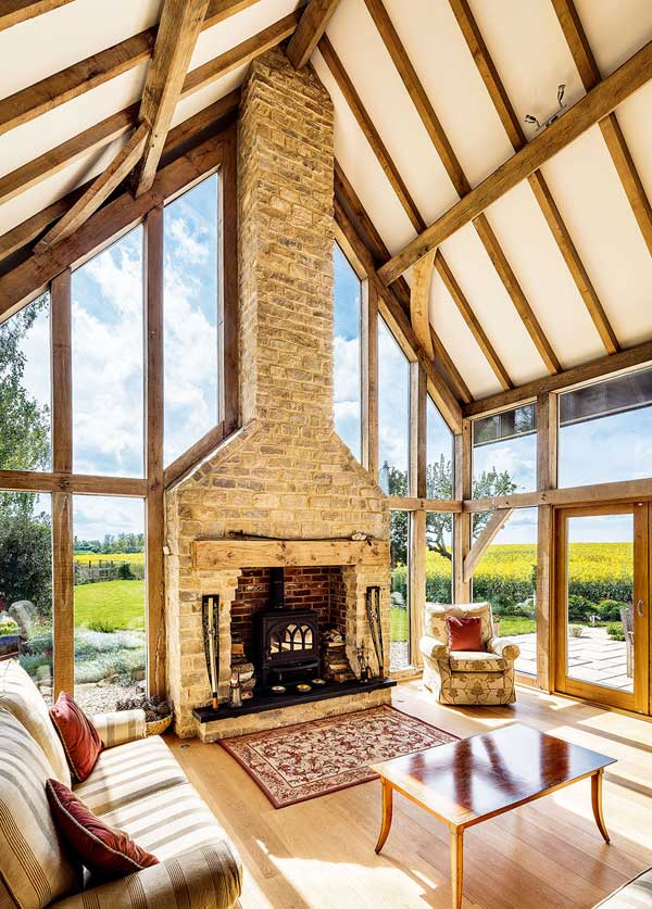 Double height drawing room with exposed chimney stack