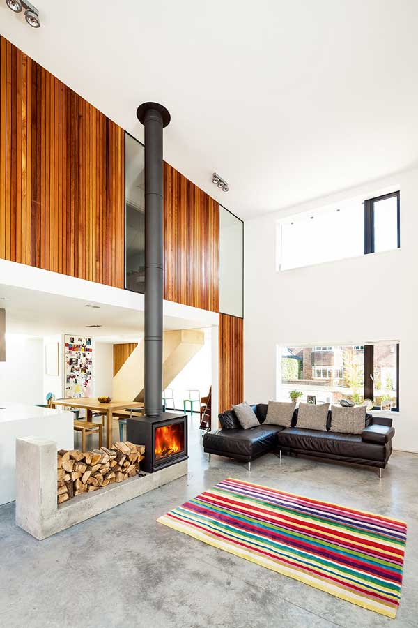 Woodburning stove in a double-height space