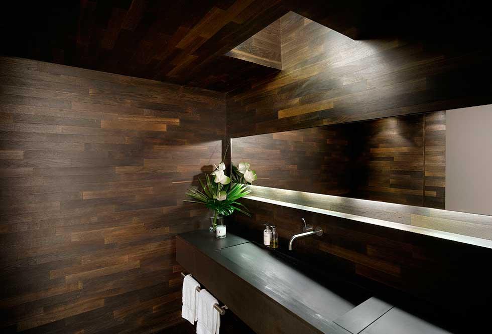 Dark wood panelling in a bathroom