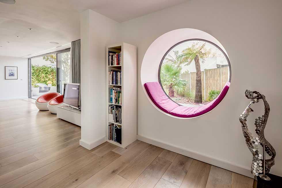 Circular window with built-in window seat