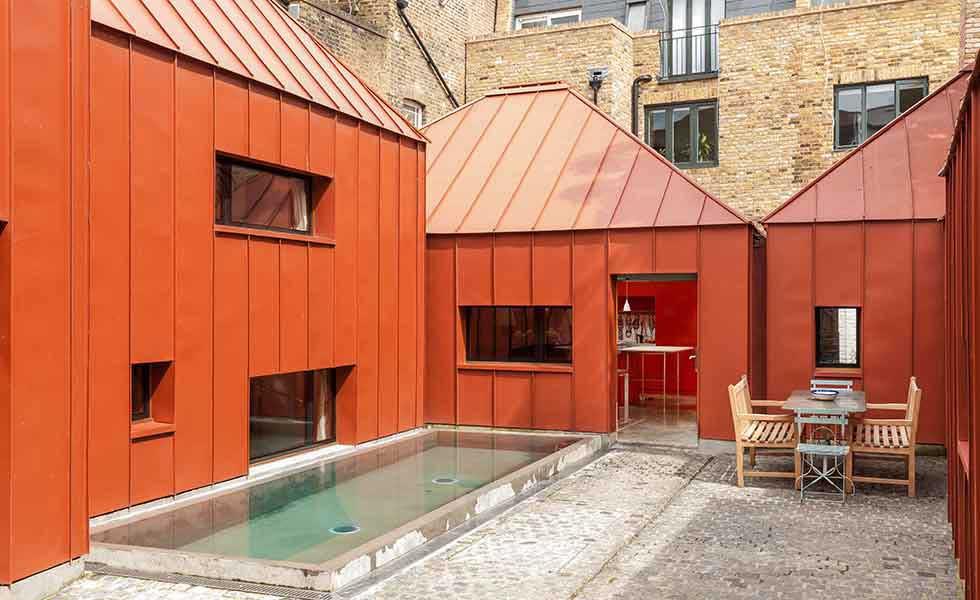 contemporary orange steel courtyard home in London