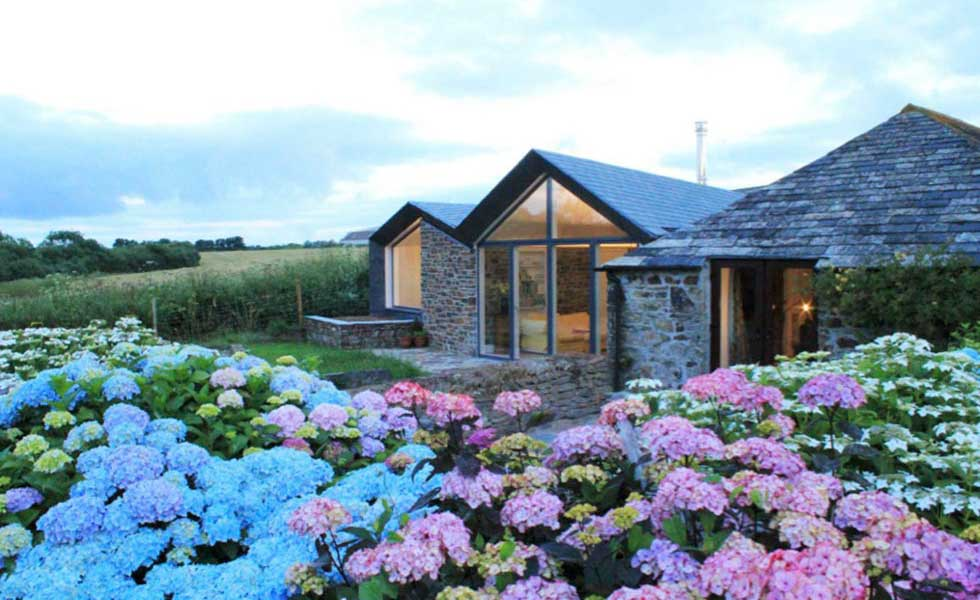 contemporary extension to stone cottage single storey