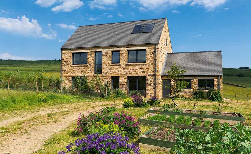 A stone-clad Passivhaus farmhouse