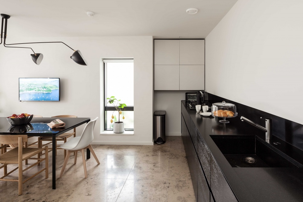 white and black contemporary kitchen with marbled floor