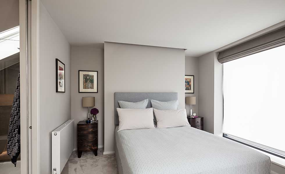grey colour scheme master bedroom with en suite and large glass window