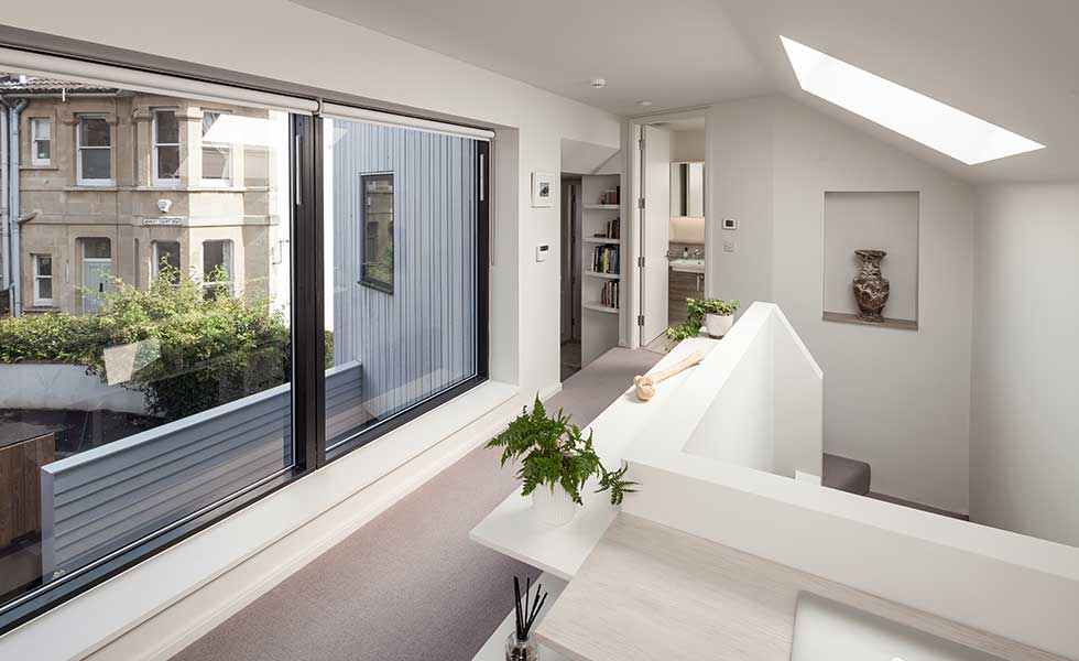 open plan living space with large glass window