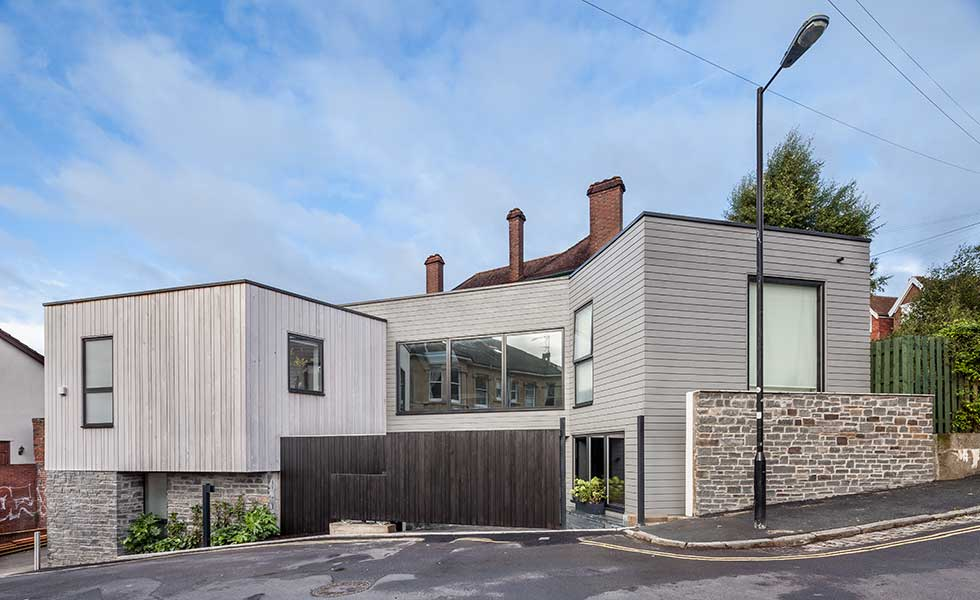 contemporary grey wooden panelled square shaped home