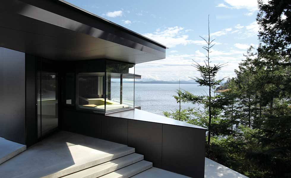 contemporary lakeside home made from modern black material