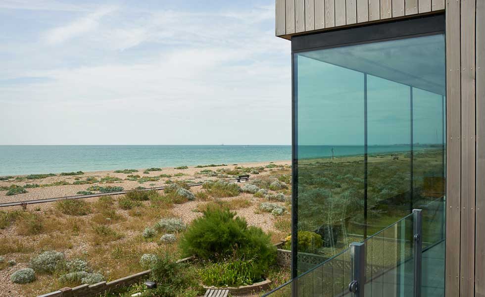 sea view from modern wooden panelled and glass beachfront home