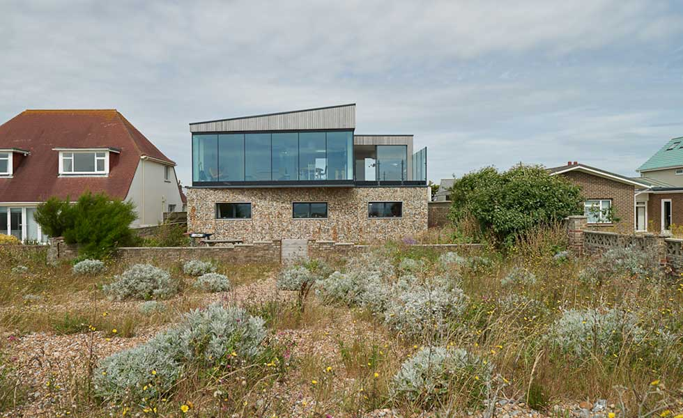 stone, wooden panelled and glass beachfront home
