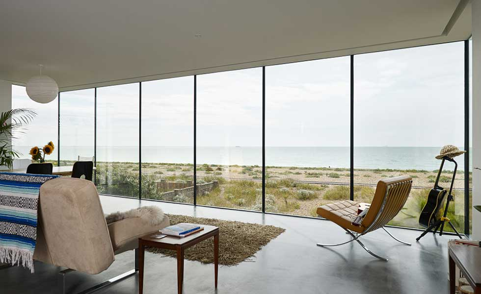 view of beach front from modern glass windowed beach house