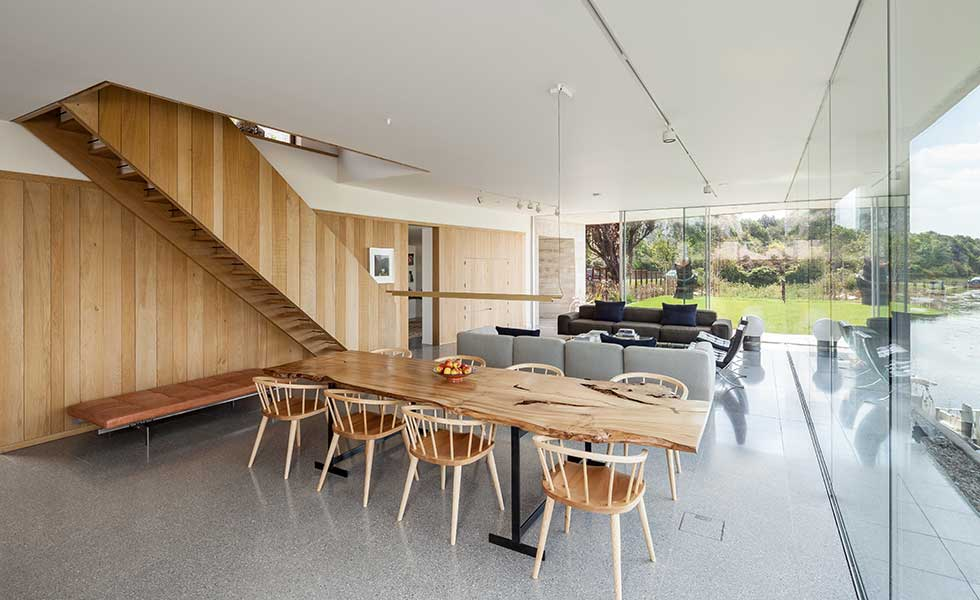 dining room with wooden table and chairs in modern open plan home