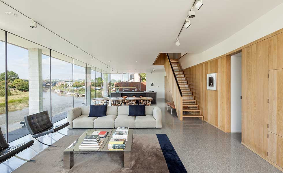 white open living space with large glass window walls