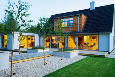 modern white bungalow with well presented garden