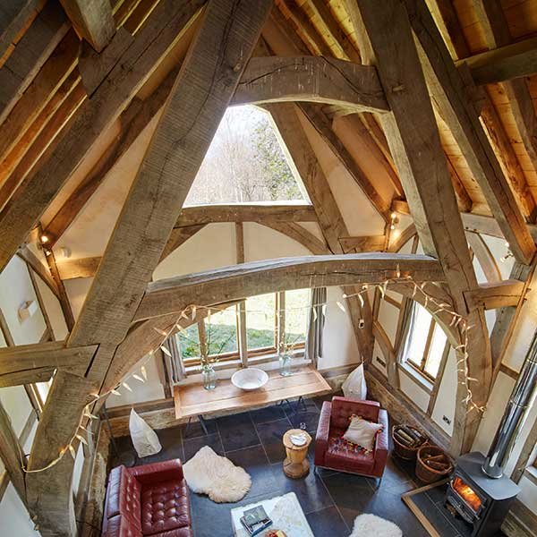 living room in barn self build with high timber frames