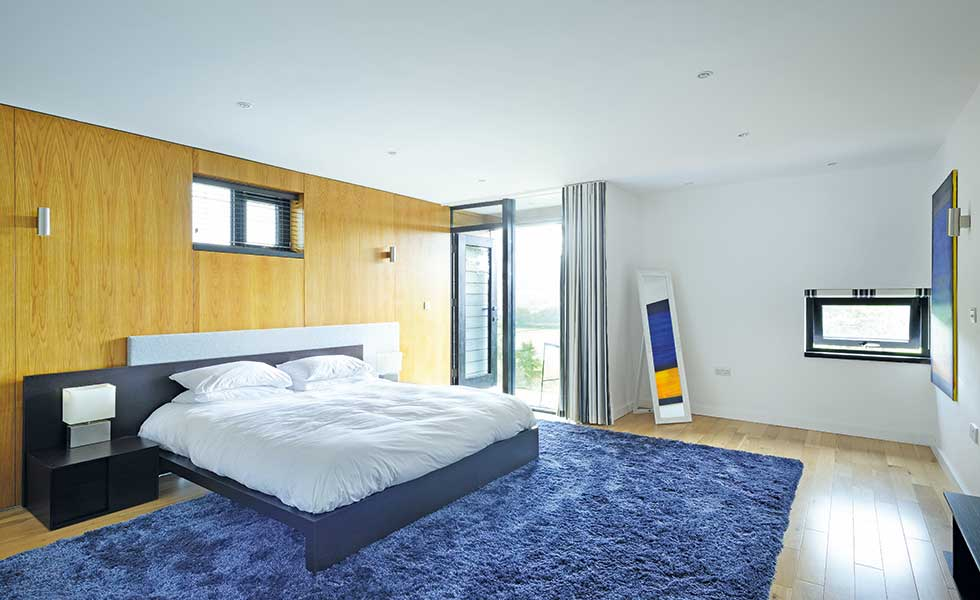 Contemporary maser bedroom with balcony