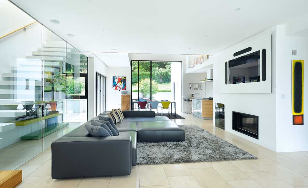 Living space separated from staircase by glass wall