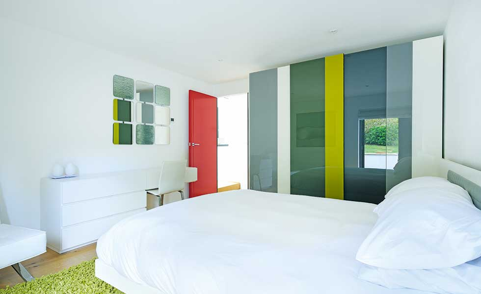 Guest bedroom with coloured glass walls