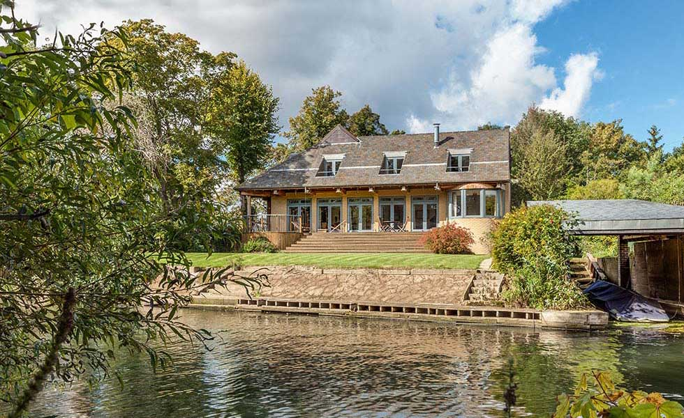 colonial style riverside home