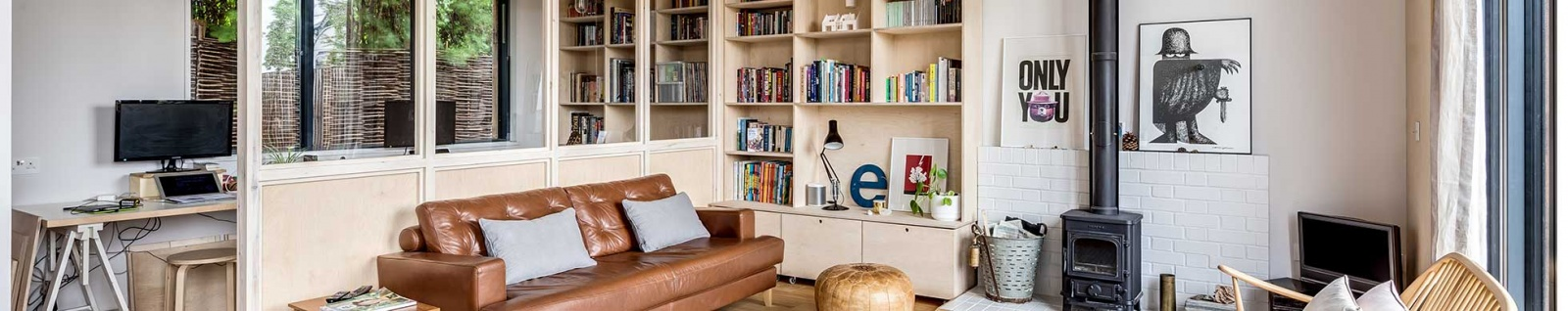 living room in a modern self build with woodburning stove and bookshelves