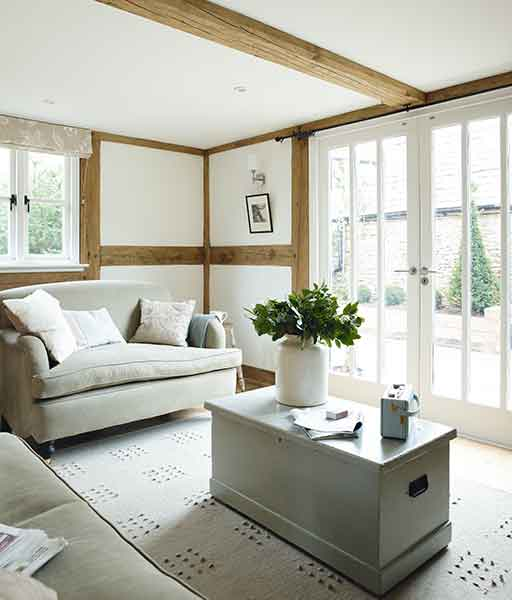 A stylish budget build features elements of exposed oak frame in the interiors