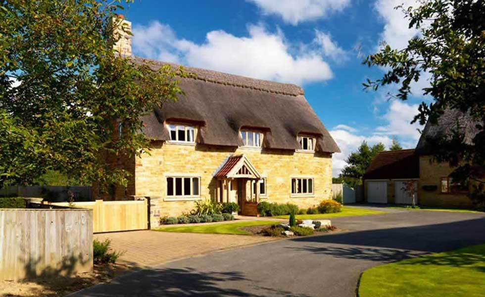 cottage self build with thatched roof