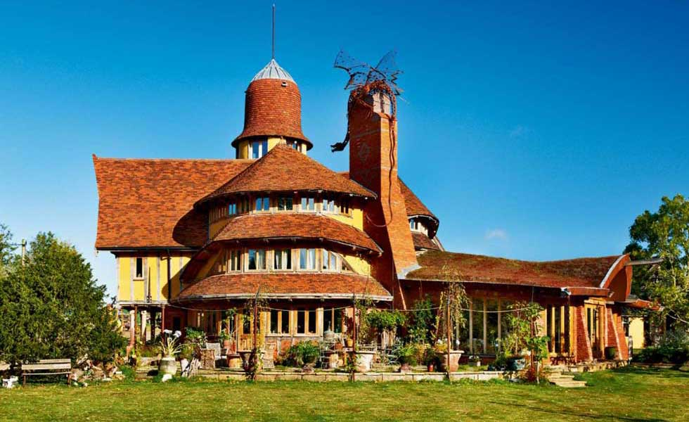 self build fantasy home with tall chimney