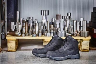 dr marten corvid black work boot metal in background